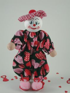 Valentine Boy Clown is dressed in a cute black background valentine fabric. His hat is made of a cute red and pink plaid. Check out those cute Send In The Clowns, Clothespin Dolls, Valentines For Boys, Wooden Pegs, Red And Pink, Black Backgrounds, Minnie Mouse, Plaid, Hat