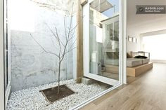 The home features an internal private Japanese garden which doubles as a light shaft, allo...