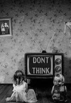 "Corporate mass media...""New technologies continue to serve as powerful tools for propaganda or mass persuasion."" This photograph displays the message that people just watch the TV and believe whatever is broadcasted across and don't take a moment to think about why. I think having the people watching in the photograph puts a more dramatic effect to the message."