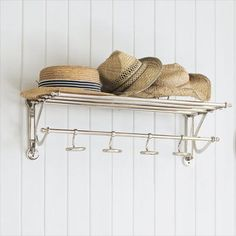 Coat and hat rack on wall.  Useful.