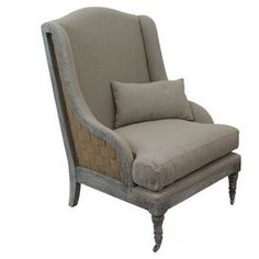 """Wood and cotton wingback arm chair with a brickwork motif and turned legs.  Product: ChairConstruction Material: Wood and cottonColor: TaupeDimensions: 42"""" H x 33"""" W x 29"""" DNote: Pillow not included"""