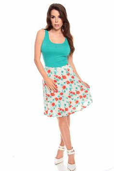 This floral print dress with a scoop neck fits perfectly with a pair of sandals and sunglasses. This is a tank top and has a loose skirt from the waist line down. 96% Polyester/ 4% Spandex. MADE IN U.S.A. 36 in. from shoulder to hemline.    #lollicouture #chic #dresses #fashion #summerfashion #summerstyle #bow