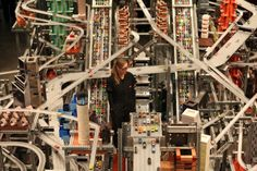 Metropolis II, a kinetic sculpture made up of 1,100 speeding toy cars.
