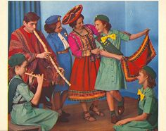 February, 1963 (Girl Scout Calendar)    Girl Guides from Peru teach one of their native dances.