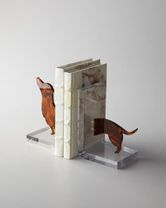 """$345 Lucite Dachshund Bookends at Horchow. Lucite Dachshund Bookends  Pair of bookends sport the front and back half of a dachshund—who's as long as your love of books! Made of Lucite®. Together, 15.5""""W x 4""""D x 7.5""""T. Imported from Italy. #daschund #homedecor #bookends"""