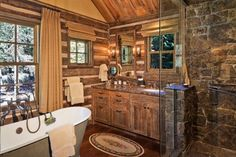 Big D Signature design. The stone work in the shower is stunning. Combination of rustic similar-toned woods.
