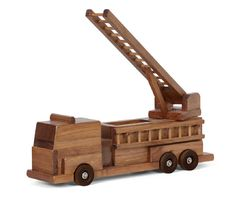 Handmade & HUGE Maple Fire Truck Working Wood Ladder Truck Toy These beautiful wooden toys are manufactured in a primitive Amish wood shop using old world carpentry skills. Each is hand cut, sanded an