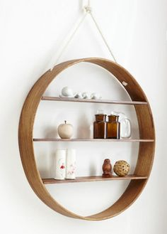 This circle shelf is a decorative way to display and store things on your wall.