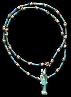 by Ancient Resource (Gabriel Vandervort) | Necklace; Ancient Egypt, Late Period, 664-535 BC. blue, red, yellow, black and green faience disc and tube beads. Strung with a beautiful and intact faience amulet of Anubis, god of the underworld | 499$ ~ sold