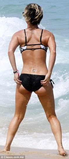 Best angles: The star showed off her derriere in the bikini as she checked out the ocean...