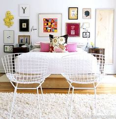 the wall of art is JUST what I am wanting in the front living room. And these bertoia chairs seem to haunt my every thought lately. I AM OBSESSED! I love the mix of traditional with the night-stand and the the modern bed.