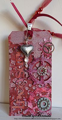 Red gears and sprockets...      Brenda used -    Tim Holtz dies - tag, gadget gears  Sissiz die - treasure  Embossing folder - steampunk  Idea-ology - sprocket gears, heart, pin  Beads and ribbons  Coredinations red card  Alcohol inks - raisin and cranberry