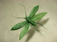 Flying Katydid . Origami is designed and folded by Sipho Mabona, folded from aprox. 16 inch of shikibu gampi-shi then wet shaped with water