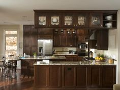 I like the small glass cupboards above the big cabinets.  Maybe I could do this to display my china.  I want to get rid of my china hutch in the kitchen area.