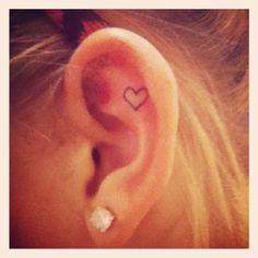 Heart ear tattoo.. I like the idea of a tiny tattoo on my ear. like a mini arrow :)