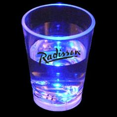 "Give a shot of success to your next special event! This light up shot glass is liquid activated for a fun and funky light up effect. Turns on when liquid is poured in and turns off when empty. This item includes the required batteries for added convenience. Measuring 2.5"" x 2"", this blue light up shot glass is the perfect item for bar openings, new year's eve parties, 21st birthday parties and weddings alike! Blank product."