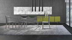 Web is a table with a special fixed, tempered glass top, available clear or in elegant grey, and a modern, tubular base consisting of a soft iron framework that gives the whole table a lightweight appearance. By Presotto