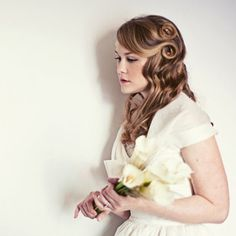 Bridemaids Hair- Some up, some down, with a distinguished pinup curl on all of them!