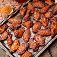 Dry-rubbed chicken wings offer a nice change of pace to typical sauced wings. This recipe with a homemade brine brings more subtle flavors to the forefront while also ensuring juicier wings. Dry Rub Chicken Wings, Smoke Chicken Wings Recipe, Smoked Chicken Wings, Chicken Wing Recipes, Smoked Meat Recipes, Rub Recipes, Grilling Recipes, Smoked Wings, Appetizer Recipes