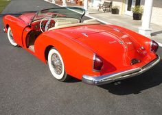1954 Kaiser Darrin. Note the doors slide into the front fenders when opening.