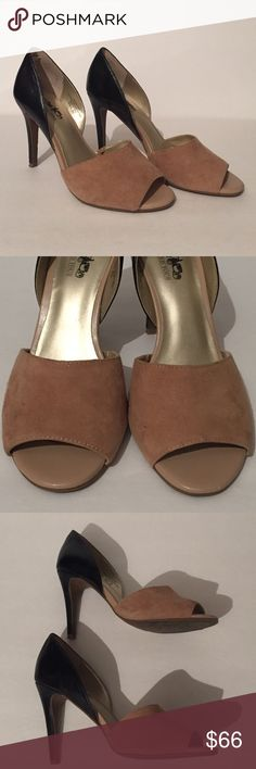Sexy Coach and four Leather peek a boo heels! This is a pair of Coach and Four Black leather and tan suede sexy peekaboo heels !! They are a size 8M and these heels have been worn twice. Heel measures approximately 4 inches. They are in great condition and extremely comfortable. See photos for details. Coach and Four Shoes Heels