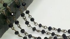 36  Inches of  4mm Faceted Round Black  Crystal  Glass Beaded   Chain with Antique Brass   Plated Metal Loops on Etsy, $14.35