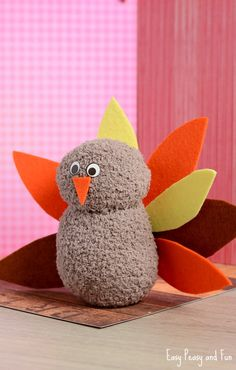 Sew it with guide from pictures and instructions.No-Sew Sock Turkey Craft - Easy Peasy and FunNo-Sew Sock Turkey CraftCute Thanksgiving Thanksgiving Crafts To Make, Christmas Crafts For Kids, Holiday Crafts, Thanksgiving Decorations, Thanksgiving Holiday, Fall Decorations, Sock Snowman Craft, Sock Crafts, Kid Crafts