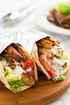 Chicken Shawarma with Yogurt  Saucye by bakingmischief: A simple chicken shawarma recipe with tender, smokey and flavorful chicken and a salty, garlic and lemon yogurt sauce served over crisp veggies and warm pita bread. #Chicken_Shawarma #Healthy