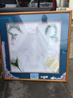 Bridal memories.  This is my mothers bridal veil, bridesmaids head pieces, silk flowers from her wedding cake and order if service. They were in a box doing nothing so I mounted them in a huge shadow box for Mother's Day.