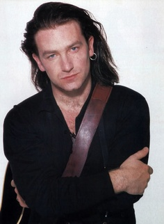"Bono, of U2. Dude, where IS that darn infamous ""red shirt"" photo?? Arrr. :P"