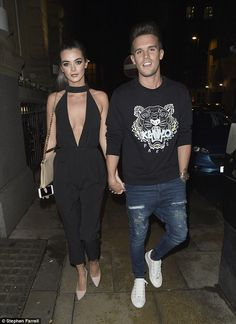 No holiday blues: Gary 'Gaz' Beadle and his girlfriend Emma McVey looked happy to be back ...