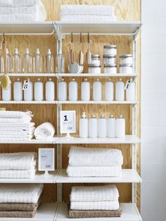 The ALGOT storage system provides sleek and clean shelving for displaying and stocking merchandise in a retail store.