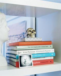 Bookshelf Photo - A stack of books on a white shelf