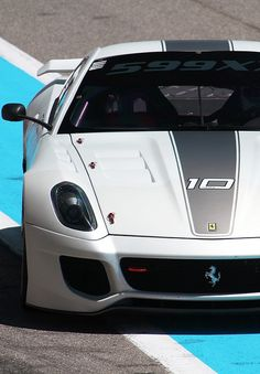 The Ferrari 599 is a sports car. The car was unveiled at the 2006 Geneva Motor Show. The car is available in coupe and convertible models Ferrari World, Ferrari Car, Exotic Sports Cars, Exotic Cars, Gt Cars, Race Cars, Gone In 60 Seconds, Bmw I8, Amazing Cars