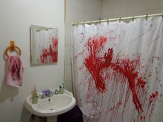 How to make your own DIY Bathroom Murder Scene for Halloween!  This scary decoration scene of horror is cheap and fun to make, and sure to please anyone who walks in!