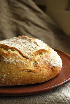 Amazing no knead recipe makes a beautiful rustic loaf.  Easily adapts to whole wheat, spelt etc.    http://www.nytimes.com/2006/11/08/dining/081mrex.html