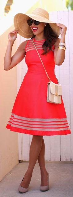 This funky bright coral dress with the wide brim hat is amazing! Also love the bright lips