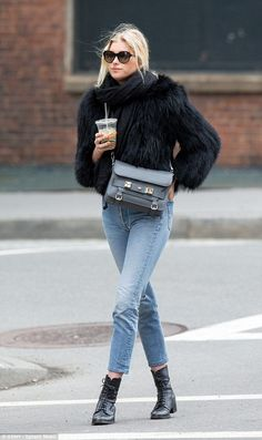Keeping cosy: Elsa Hosk opted to keep a low-profile as she was pictured running errands in...