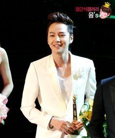 Jang Geun Seok as 'Prince Charming' in white