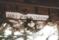 Elizabeth Wray Design-Sign hung above where the couple was married in a barn on the family's estate.