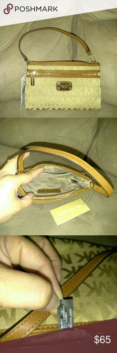 BNWT Michael kors Wristlet tiny bag Authentic brand new MK wristlet tiny bag Gold beige brown color  3 credit cards slot inside and 1compartment 1 zippered compartment  Size 8 x 4.5  All kind of cellphone will fit Michael Kors Bags
