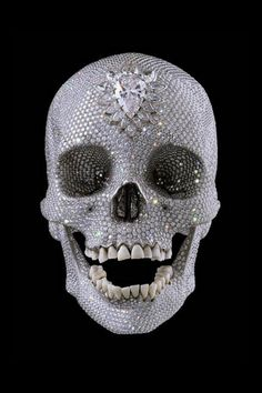 bling skull...with real teeth? creepy creeperson.
