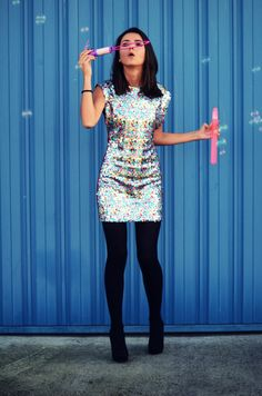 Sparkly dress obsession, i love the way the black tights look with this dress.