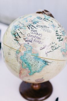 Use a Globe as an Alternative to a Guest Book -- See the wedding on SMP: http://www.StyleMePretty.com/rhode-island-weddings/bristol/2014/02/17/navy-gray-mount-hope-farm-wedding/ Erin McGinn Photography