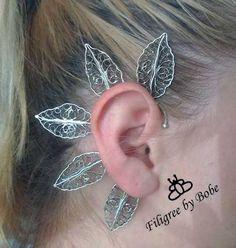 Silver filigree earring.
