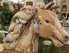 antique wooden horse - would love to have this in my garden.....