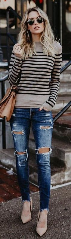 gray and black striped shirt, distressed blue-washed fitted jeans, and nude-colored pointed toe heels outfit