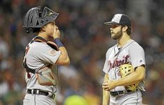 Detroit Tigers starting pitcher Daniel Norris, right, talks with catcher James McCann in the second inning of a baseball game against the Cleveland Indians, Monday, July 4, 2016, in Cleveland. (AP Photo/Tony Dejak)