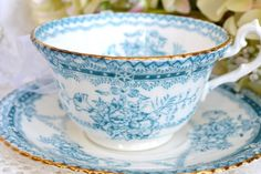 Teal and white teacup and saucer
