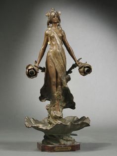 Art Nouveau Figural Patinated Spelter Lamp Base, France, early 20th century, L. & E. Moreau studio, electrified, depicting a nymph modeled standing and supporting a rose-form light fixture in either hand and set atop a leaf-form base on a cut corner marble stand, titled plaque Le Parfum par Louis Moreau